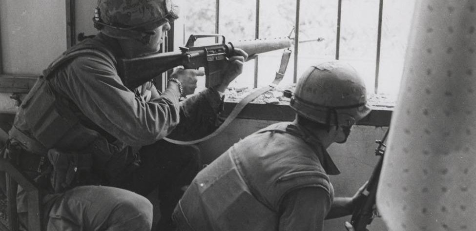 Marines_Fire_From_a_House_Window,_February_1968_(16242259837)_(cropped)